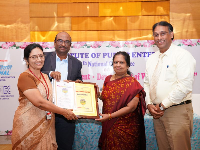 Ms P L Rupa Devi from HAL is Receiving the Excellence Award from Ms. Swarna Sankaran, ED(Fin), ECIL