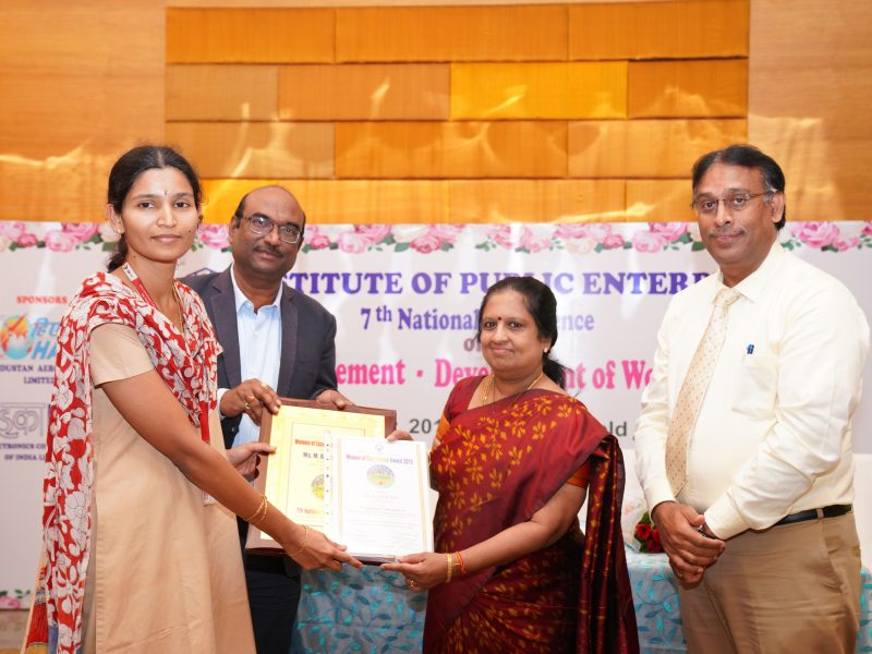 Ms. M Annapurna from BDL is Receiving the Excellence Award from Ms. Swarna Sankaran, ED(Fin), ECIL