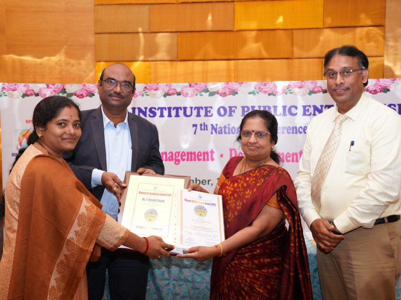 Ms. P Revathi Pavani from HAL is Receiving the Excellence Award from Ms. Swarna Sankaran, ED(Fin), ECIL